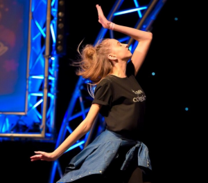 A dance soloist competes at a Championship event