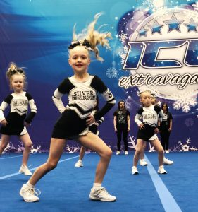 A cheer team compete at an ICE Extravaganza Cheer and Dance event