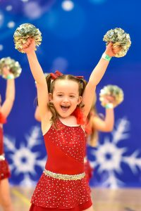 A dancer competes in a pom division at Incredibly Cool Events