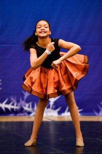 A soloist competes in dance at an ICE Event