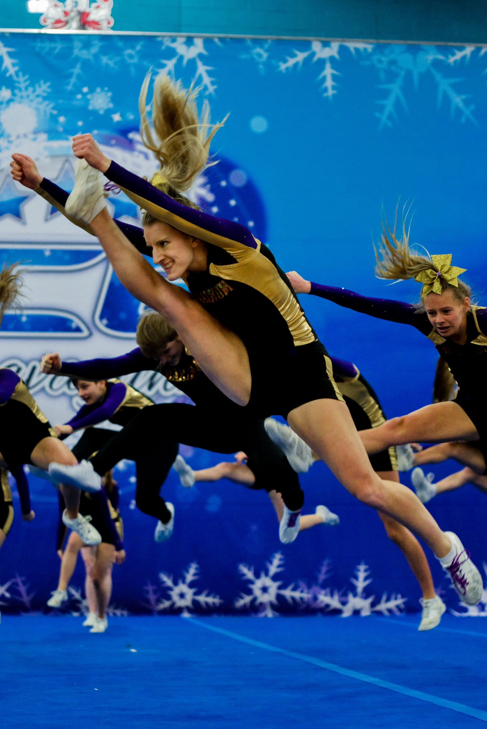 Athletes compete cheer jumps at an ICE Extravaganza competition