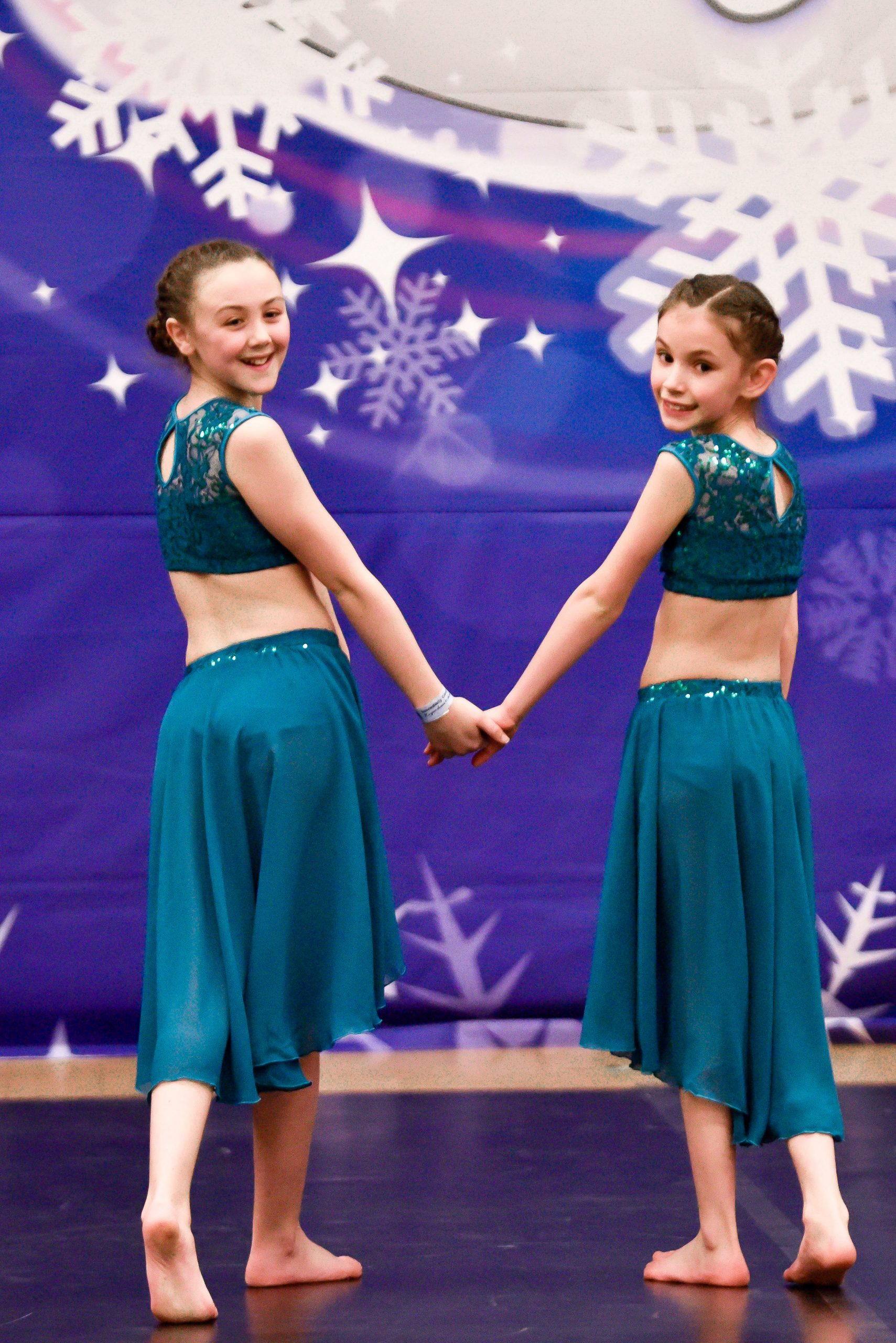Dancers compete on a dance floor at an ICE Extravaganza Cheer and Dance event
