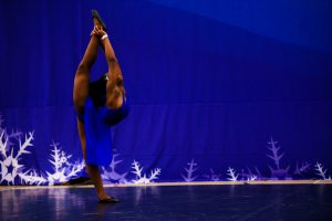 A dance soloist competes on a dance floor at Incredibly Cool Events