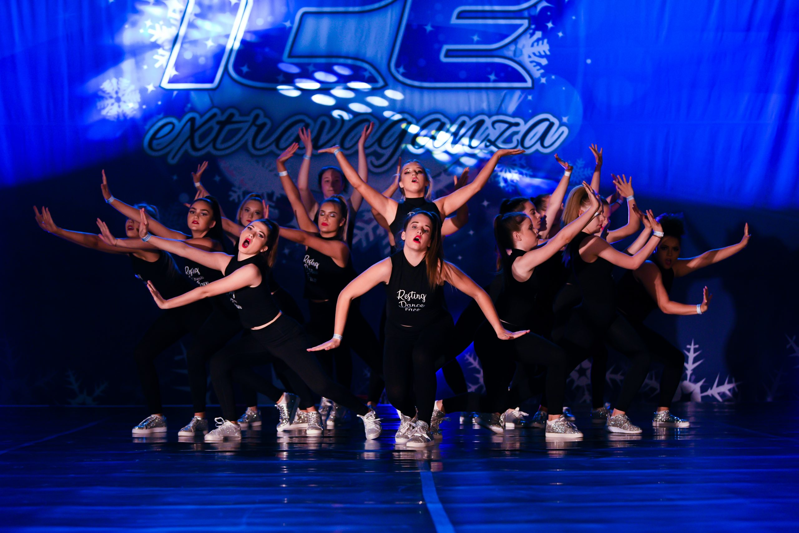 A dance team dressed in black compete at ICE Championships