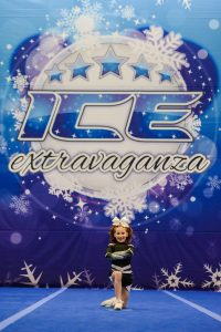 A cheer soloist competes at an ICE Extravaganza Cheer and Dance event