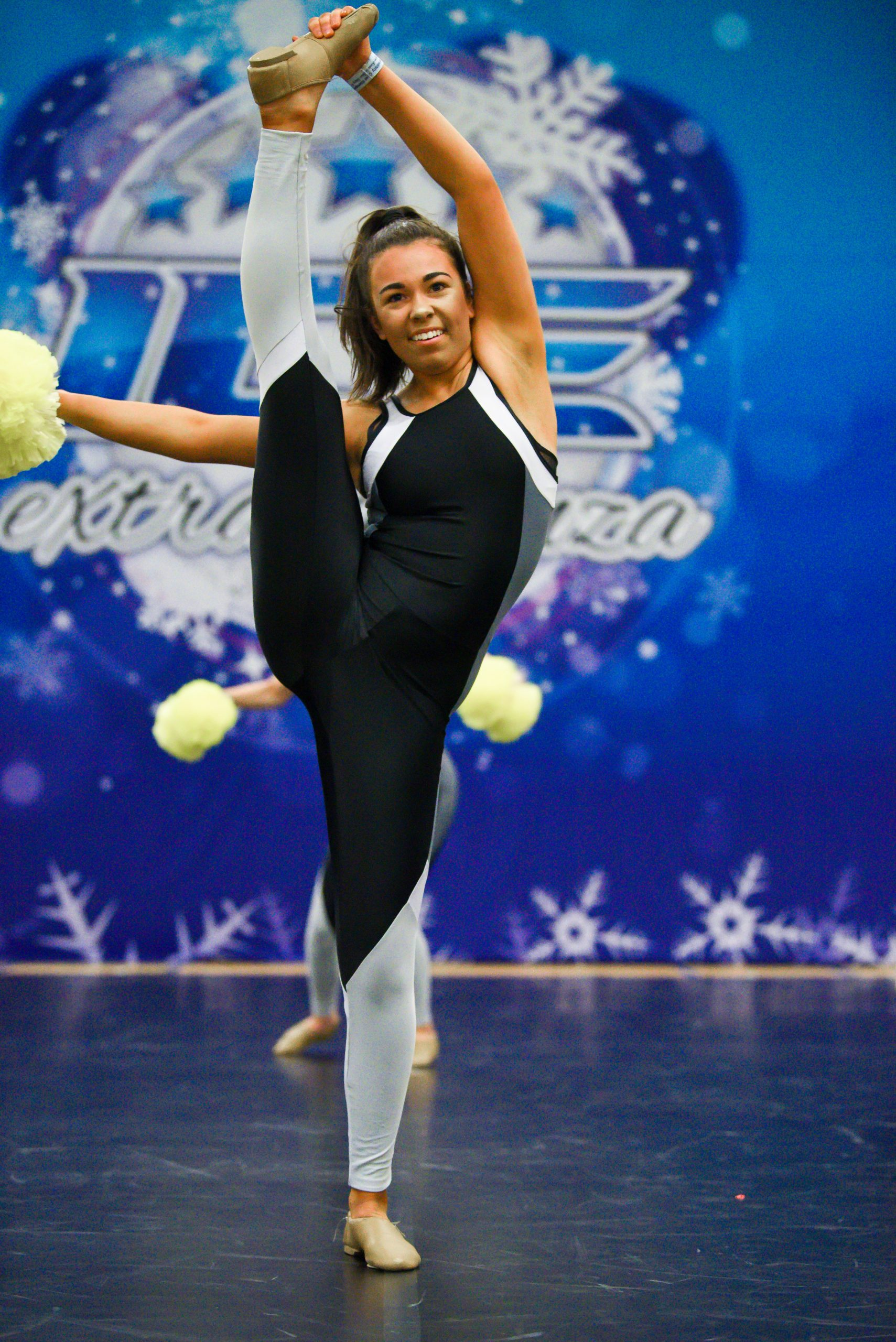A dancer competes as part of a team in a pom division at Incredibly Cool Events