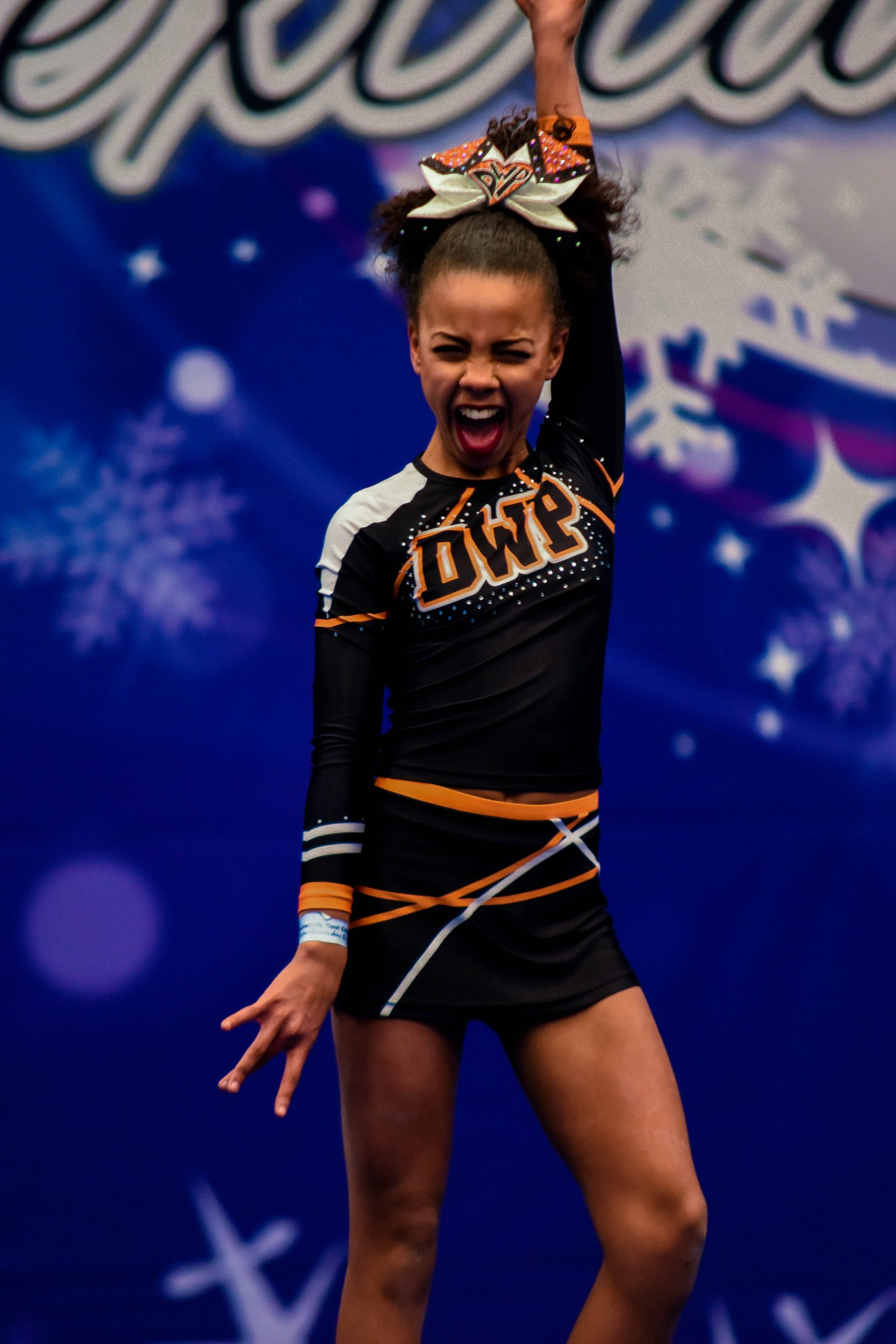 A cheer athlete competes at ICE Northern Frostbite