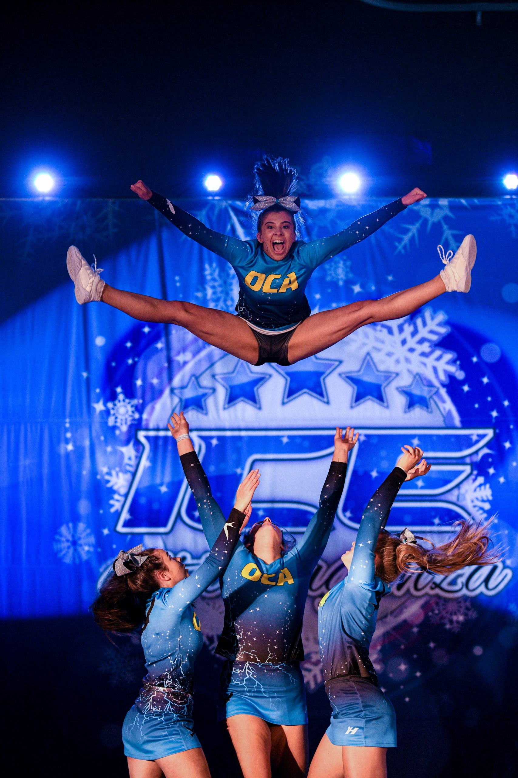 A cheer team compete a basket toss at ICE Championships