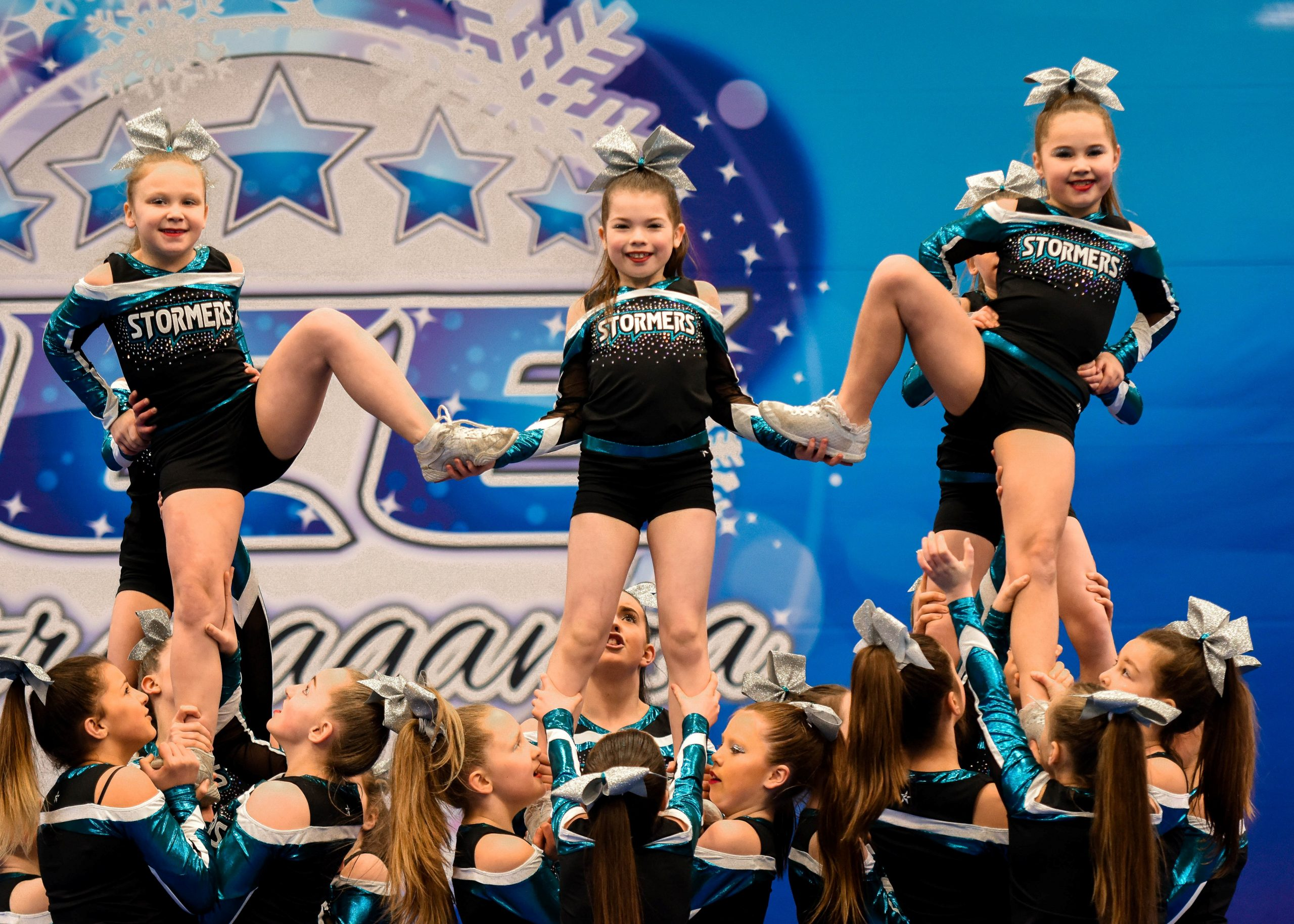 A cheer team compete in a pyramid at Incredibly Cool Events