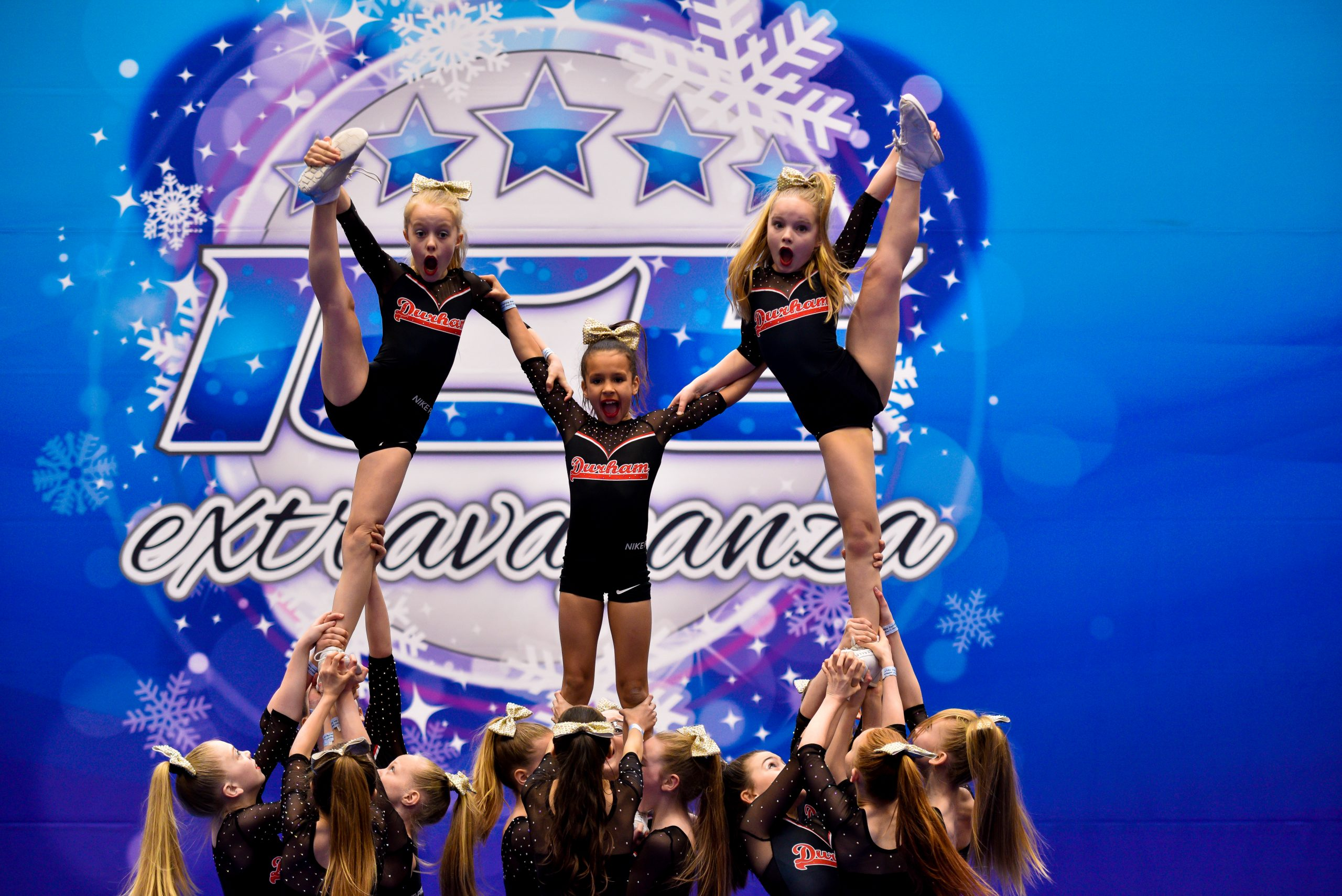 A cheer team compete in a pyramid at ICE Blizzard